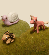 Tiny miniature snail unicorn and rabbit